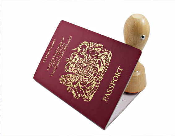 passport gets stamped by Immigration Solicitors in Manchester